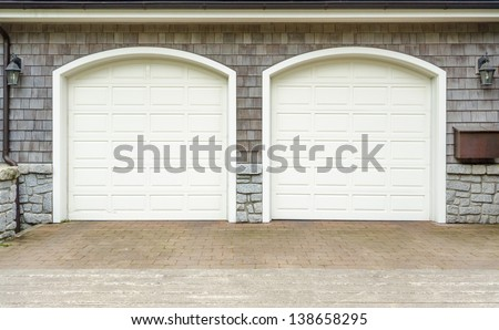 Fragment of a luxury house with a double garage door in Vancouver, Canada. - stock photo