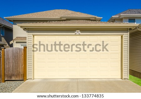 Fragment of a luxury house with a garage door in Vancouver, Canada. - stock photo