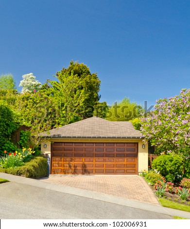 Fragment of a luxury house with garage door in Vancouver, Canada. - stock photo