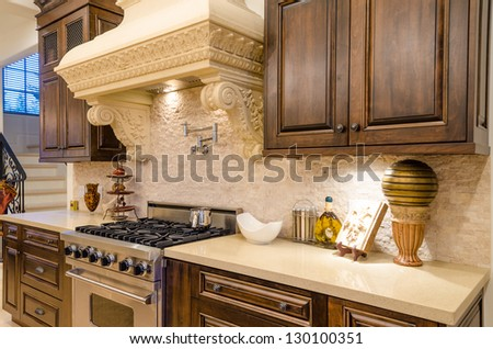 Fragment of a luxury kitchen in a house - stock photo