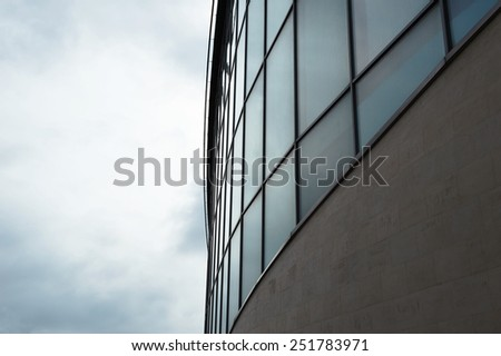 Fragment of a modern building against the sun in overcast weather