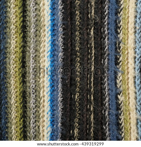 Fragment of a motley striped cloth fabric material texture as an abstract background composition - stock photo