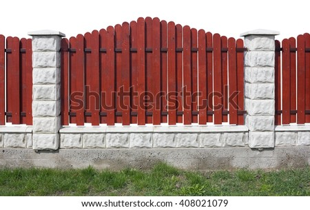 Fragment of a new rural fence. The fence is made of red wooden planks, columns and the base are made from white bricks. Isolated on white - stock photo