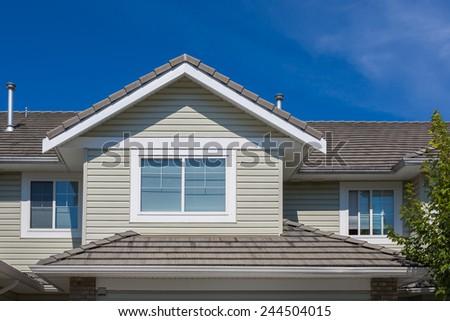 Fragment of a nice house. Top floor window. - stock photo