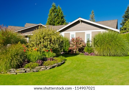 Fragment of a nice house with gorgeous outdoor landscape in Vancouver, Canada. - stock photo