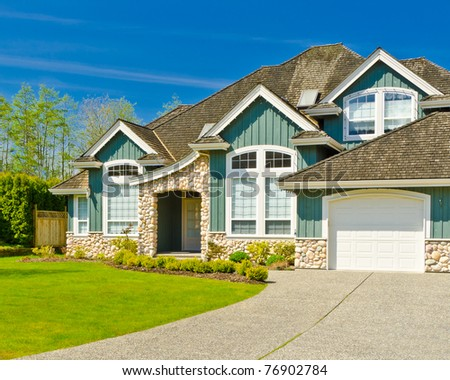 Fragment of a nice house with green in front in Vancouver, Canada. - stock photo