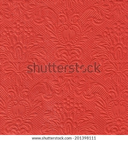 Fragment of a paper napkin. Background Detail of colored paper napkins with stamping
