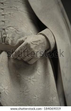 fragment of a statue of Giotto. Statue outside the Uffizi, Florence, Italy  - stock photo