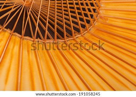Fragment of a traditional Japanese umbrella made of bamboo and paper. - stock photo