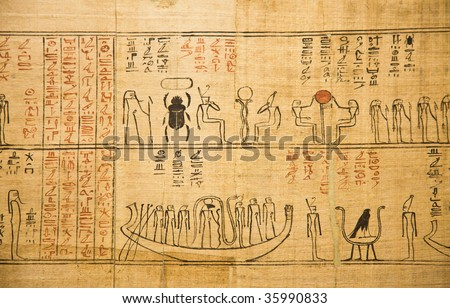 Fragment of a very old Egyptian papyrus - stock photo