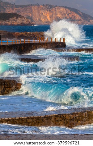 Fragment of Adriatic coast with a sea surf - stock photo