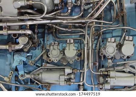 Fragment of aircraft turbo-jet engine, background - stock photo