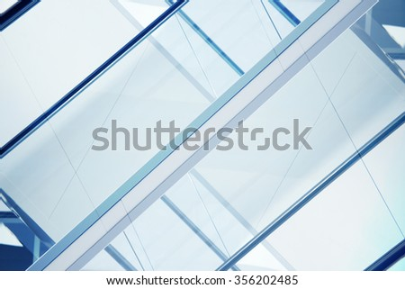 Fragment of all-over glazing facade. Sample of contemporary architecture with massive windows. Inartificial urban background with a lot of frames for text fragmentation. Modern design motif. - stock photo