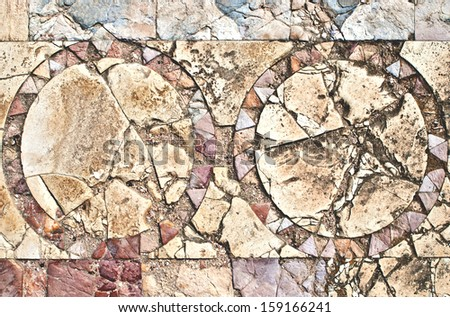 Fragment of an ancient  floor mosaic. Colorful tiles and stones of different sizes, unusual geometric ornament, regular forms.Euthemius Monastery. Euthymius Monastery. Israel - stock photo
