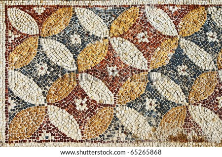 Fragment of an ancient geometrical colorful floor mosaic in Herod`s Palace, Caesarea, Israel