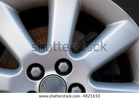 fragment of an auto wheel made of light alloy - stock photo