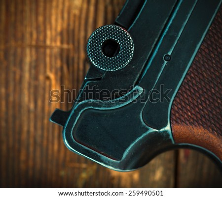 fragment of an old Parabellum pistol. Luger close up. instagram image retro style - stock photo