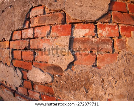 Fragment of an old shabby brick wall with wide angle fisheye lens view - stock photo