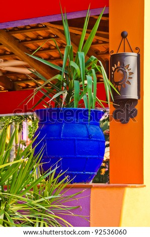 fragment of an open lobby interior of a hotel with plant in pot and wall light - stock photo