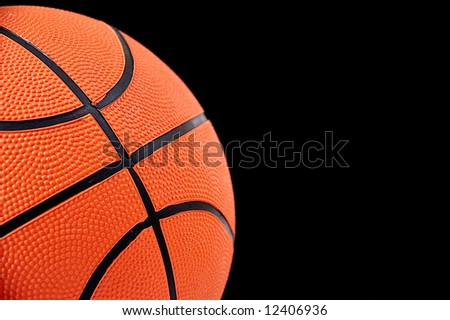 fragment of basketball ball on black background.
