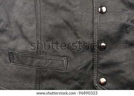Fragment of black leather vest - stock photo