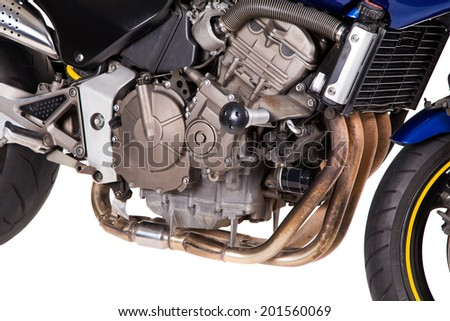 Fragment of Blue powerful motorcycle. Isolated on a white background.