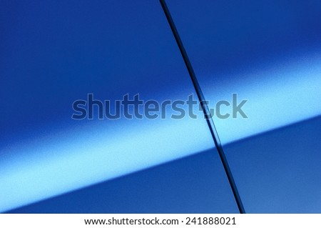 Fragment of blue steel car body. Vehicle paint coating texture. Abstract. - stock photo