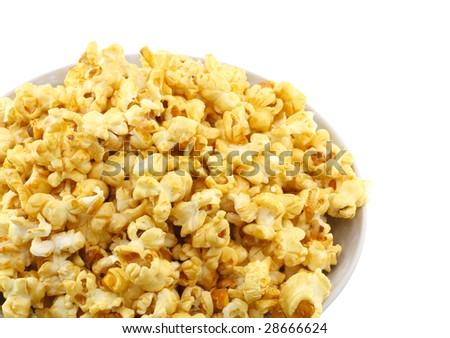 Fragment of bowl full of caramel popcorn isolated on white background. - stock photo