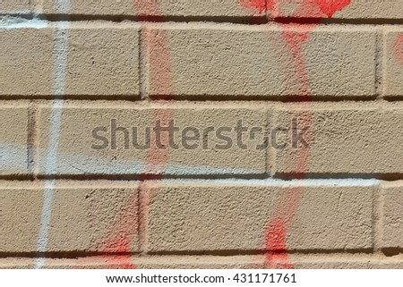 fragment of brick wall with traces of paint