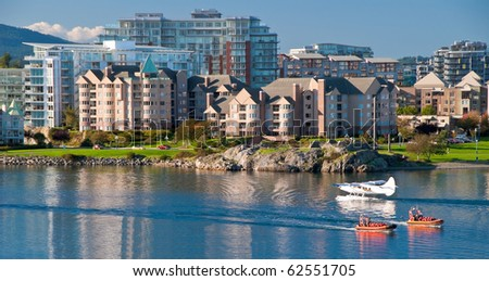 Fragment of busy harbor at downtown of Victoria, Canada. - stock photo