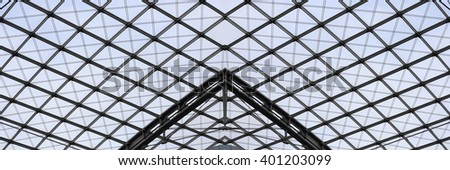Fragment of ceiling or roof modular supporting structure. Steel and glass contemporary architecture. Structural glazing. Abstract architectural composition with checkered pattern. - stock photo