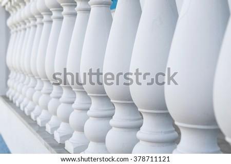 Fragment of classical column stone banister or balustrade in white - stock photo