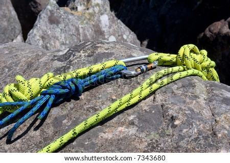 Fragment of climbing rope on rock. Shot in Jonkershoek Nature Reserve, Stellenbosch, Western Cape, South Africa. - stock photo