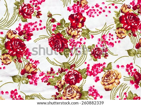Fragment of colorful retro tapestry textile pattern with floral ornament useful as background - stock photo