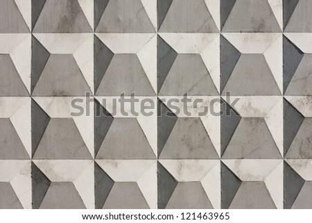 Fragment of concrete slab with a regular prismatic pattern - stock photo
