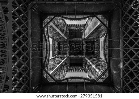Fragment of construction Eiffel Tower (La Tour Eiffel). Paris, France. Eiffel Tower named after engineer Gustave Eiffel, is tallest structure in Paris and most visited monument in world. Black & white - stock photo