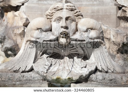 Fragment of decorative fountain with sculptures of woman and dolphins. Italy, Roma. Piazza della Rotonda. Fontana del Pantheon - stock photo