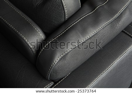 Fragment of expensive leather sofa - stock photo