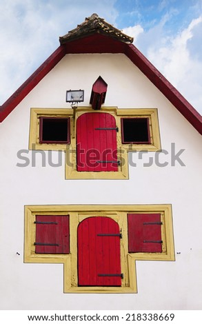Fragment of facade of old medieval house with distinctive red wooden shutters in Rothenburg ob der Tauber, Bayern, Germany - stock photo