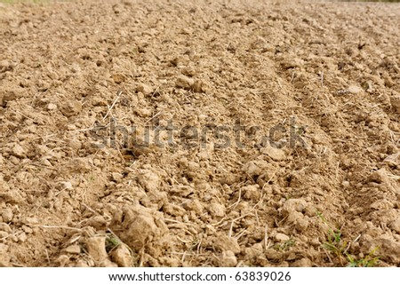 Fragment of field with plowed soil - stock photo