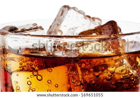 Fragment of glass cola with ice isolated on white background - stock photo