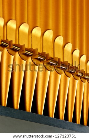 Fragment of golden organ pipes.