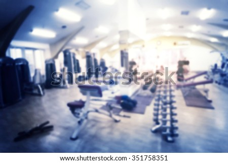 Fragment of gym with exercise equipment shot with blur