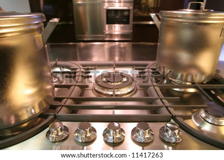 fragment of interiors of modern kitchen with gas fryer - stock photo