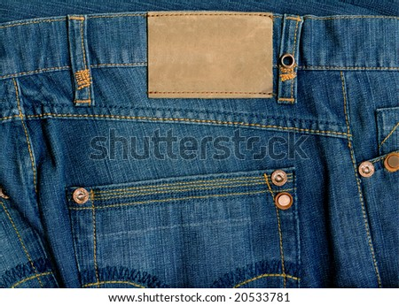 Fragment of jeans with pure label  for your text. - stock photo