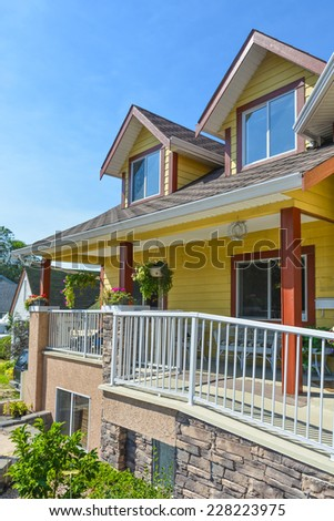 Fragment of luxury residential house with patio in front and blue sky background, Canada. - stock photo