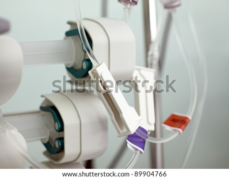 fragment of medical infusion system - stock photo