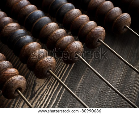 Fragment of old abacus close up - stock photo