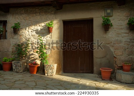 Fragment of old house in Potes, Spain - stock photo