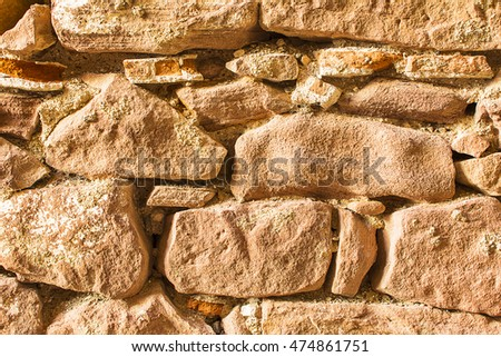 Fragment of old stone wall closeup
